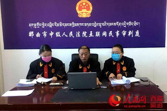 西藏那曲市中级庶民法院灵巧调节办案花样